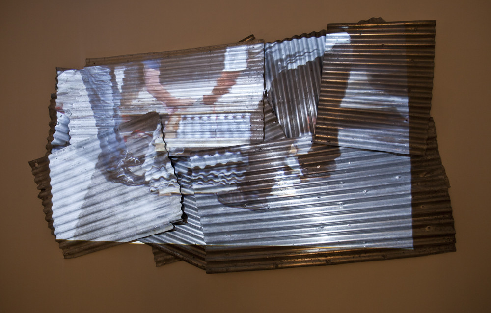 Histoires de tôles / Sheet Metal Stories, 2015. Video projection and sheet metal.